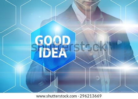 Businessman pressing good idea button on virtual screens. Business, technology, internet and networking concept. - stock photo