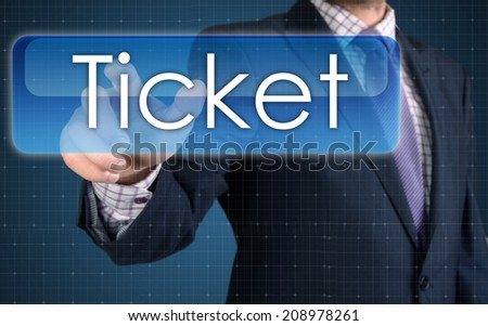 Businessman pressing high tech type of modern Ticket button  - stock photo
