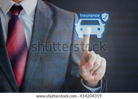 Businessman pressing insured car icon in the air with one finger - car insurance concept - stock photo