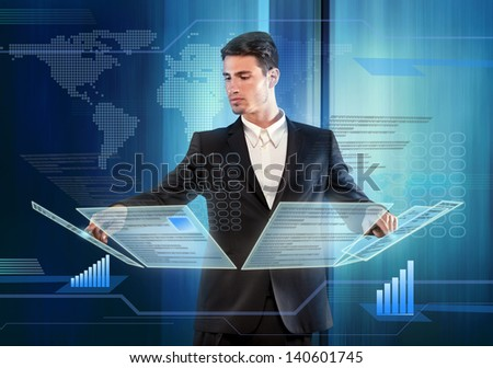 Businessman pressing items on a touch screen panel - stock photo