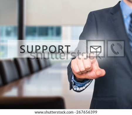 Businessman pressing mail icon ,touch screen button. Isolated on office. Communication concept. Stock Image - stock photo