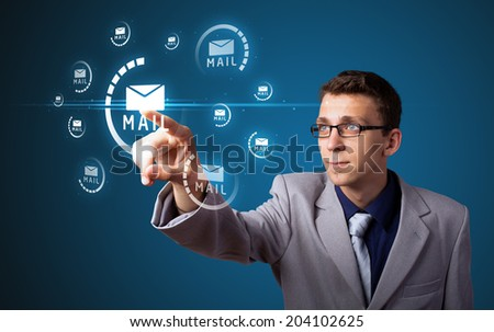 Businessman pressing messaging type of modern icons with virtual background - stock photo
