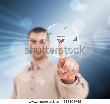 Businessman pressing modern buttons on a virtual background - stock photo