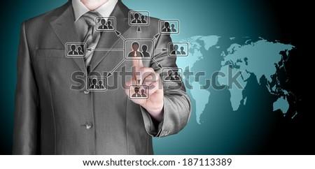 Businessman pressing modern social buttons - stock photo