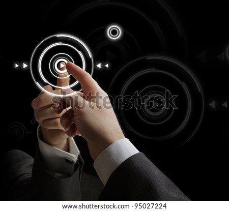 Businessman pressing multimedia type - stock photo