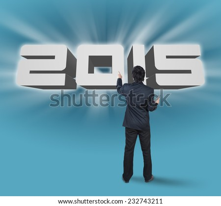 Businessman pressing on 2015, business concept for annual planning - stock photo