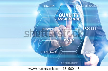 Businessman pressing on virtual screen and select Quality ssurance concept.