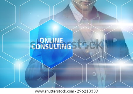 Businessman pressing online consulting button on virtual screens. Business, technology, internet and networking concept. - stock photo