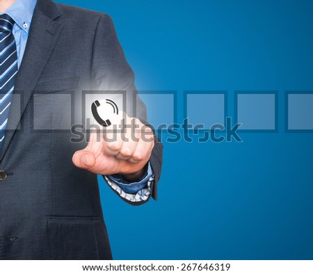 Businessman pressing phone button, visual screen. Communication concept. Isolated on blue. Stock Image - stock photo