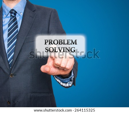 Businessman pressing Problem Solving  button on visual screen. Isolated on blue background. Stock Photo - stock photo