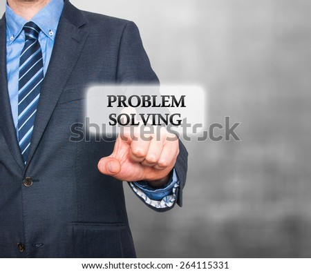 Businessman pressing Problem Solving  button on visual screen. Isolated on grey background. Stock Photo - stock photo
