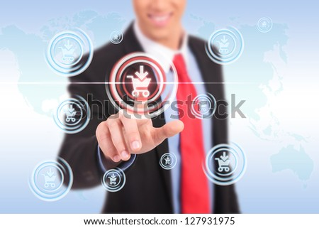 Businessman pressing promotion and shopping button on a futuristic interface - stock photo