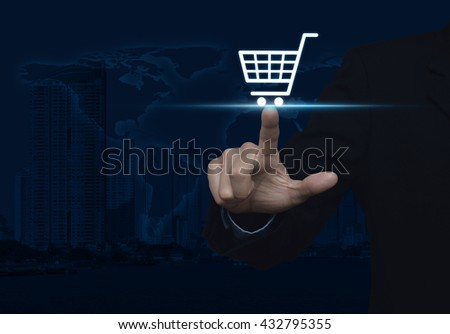 Businessman pressing shopping cart icon over map and city tower, Shopping online concept, Elements of this image furnished by NASA
