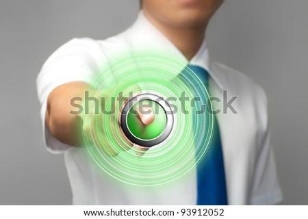 Businessman pressing start button - stock photo