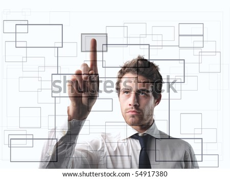 Businessman pressing the cell of a digital graphic - stock photo