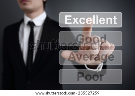 Businessman pressing touch screen interface and and selects excelent button. - stock photo