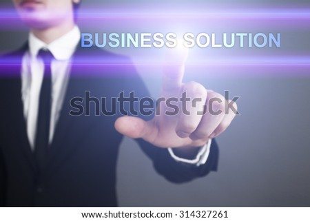 """Businessman pressing touch screen interface and select """"Business solution"""". Business concept. Internet concept. - stock photo"""