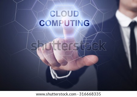 "Businessman pressing touch screen interface and select ""Cloud computing"".  - stock photo"