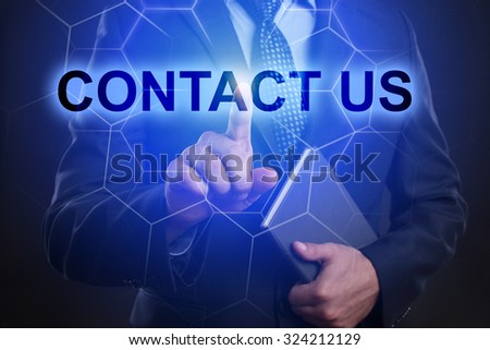 "Businessman pressing touch screen interface and select ""Contact us"". - stock photo"