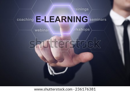 Businessman pressing touch screen interface and select E-learning. E-learning education concept - stock photo
