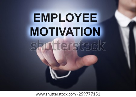 Businessman pressing touch screen interface and select employee motivation. business concept - stock photo