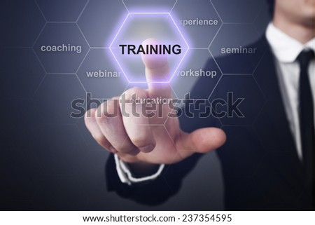 Businessman pressing touch screen interface and select icon training - stock photo