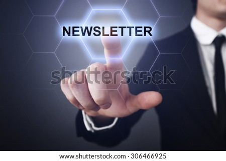 "Businessman pressing touch screen interface and select ""newsletter"". business concept. - stock photo"