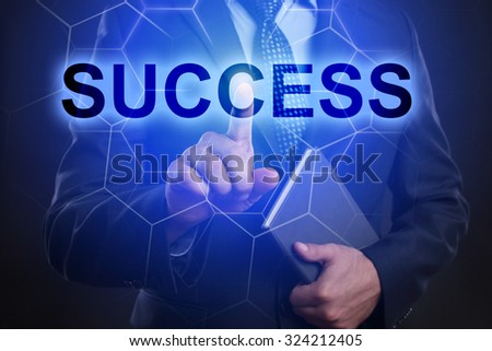 "Businessman pressing touch screen interface and select ""Success""."
