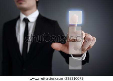 Businessman pressing touch screen interface concept. chooses one of the four - stock photo