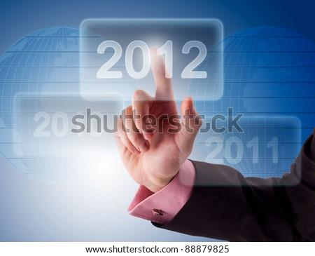 Businessman pressing virtual button New 2012 Year - stock photo