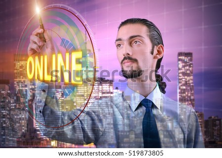 Businessman pressing virtual button online