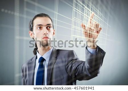 Businessman pressing virtual buttons in futuristic concept - stock photo