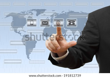 Businessman pressing virtual ( mail,phone,email ) buttons. support concept - stock photo