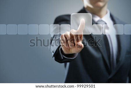 Businessman pressing virtual media type of buttons - stock photo