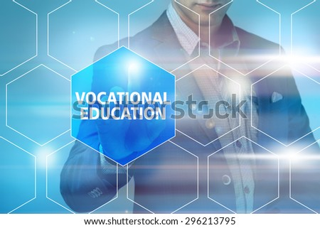 Businessman pressing vocatiinal education button on virtual screens. Business, technology, internet and networking concept. - stock photo