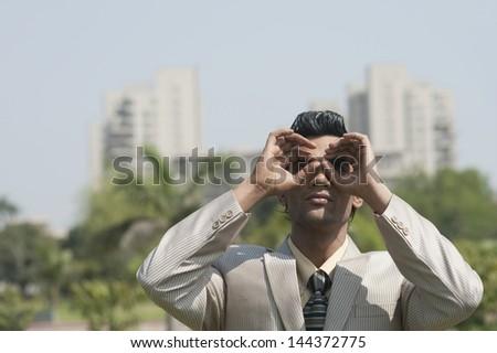 Businessman pretending to wear glasses - stock photo