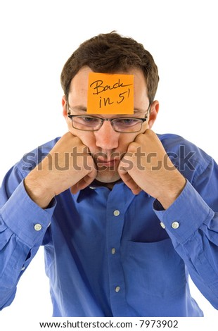 Businessman propping his head, taking a five minutes break - isolated - stock photo