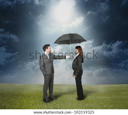 Businessman protect a woman with umbrella.