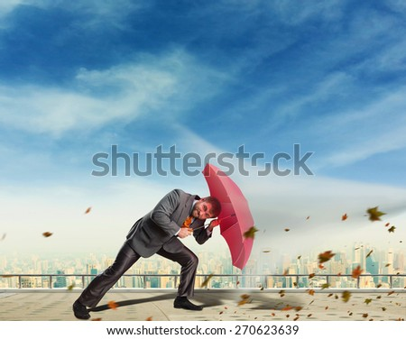 Businessman protects himself from crisis - stock photo