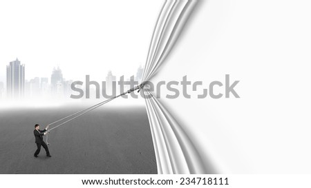 businessman pull open blank curtain covering gray cityscape isolated on white background - stock photo