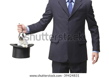 Businessman pulling a rabbit out of a silk top hat - stock photo