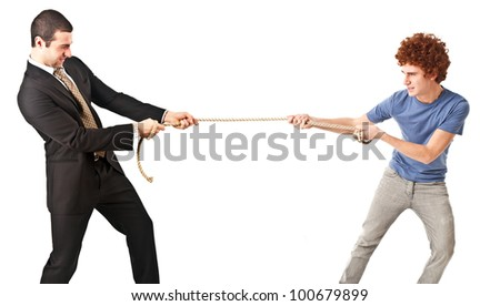 Businessman pulling a rope against a young man - stock photo