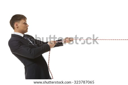 Businessman pulling a rope isolated on white background
