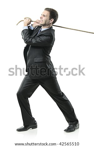 Businessman pulling a rope isolated on white background - stock photo