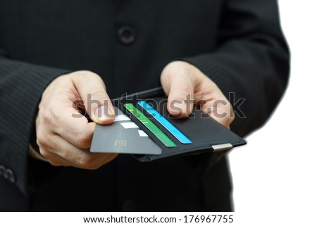 businessman pulling credit card from wallet to pay - stock photo