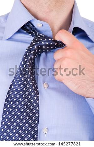 Businessman pulling his collar. - stock photo