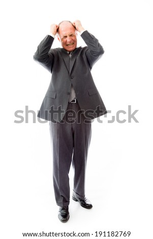 Businessman pulling his hair and screaming in frustration - stock photo