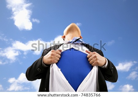 Businessman pulling  his t-shirt open - stock photo