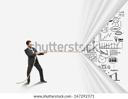 businessman pulling rope and drawing  business concept - stock photo