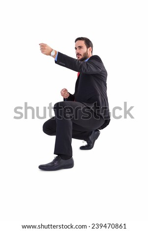 Businessman pulling something with effort on white background - stock photo